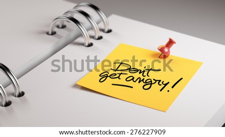 Closeup Yellow Sticky Note paste it in a notebook setting an appointment. The words Don't get angry written on a white notebook to remind you an important appointment. - stock photo