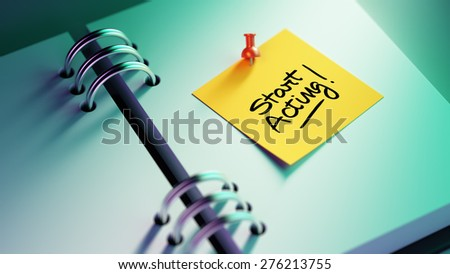 Closeup Yellow Sticky Note paste it in a notebook setting an appointment. The words Start Acting written on a white notebook to remind you an important appointment. - stock photo