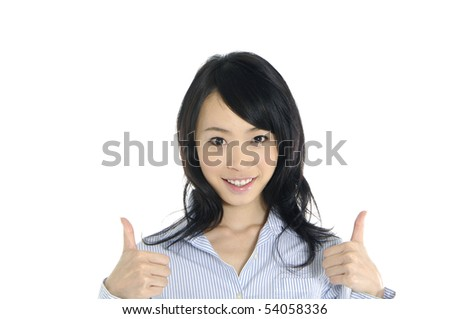 Closeup young lady showing thumb's up sign - stock photo