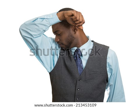Closeup young man, smelling sniffing his armpit, something stinks bad, foul odor isolated white  background. Negative human facial expressions, feeling body language, perception. Personal hygiene - stock photo