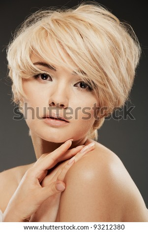 Closeup young woman portrait with clear skin and short  hairdress on white hair. Soft desire emotion - stock photo