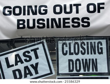Closing down signs in high street shop window - stock photo