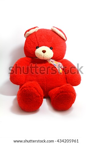 closs up teddy bear in red on a white background .