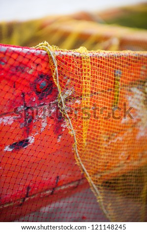 Closup of an old colorful fishing net on fishing boat in Kerala - stock photo