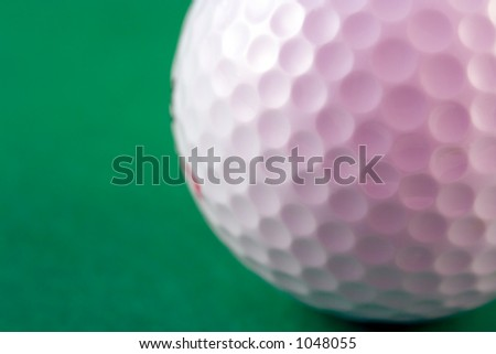Closup of the dimples of a golf ball (shallow dof) - stock photo