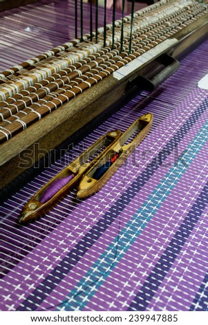 Cloth and loom, loom and Shuttle weaving - stock photo