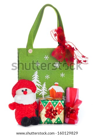 Cloth bag with Christmas decorations and gifts boxes on white background - stock photo