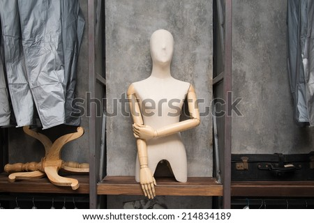 cloth dummy and bags on shelf - stock photo