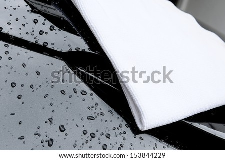 cloth for wipe the water during car washing - stock photo