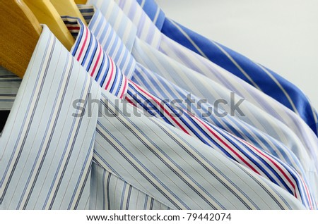 Cloth Hangers with Shirts - stock photo