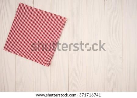 cloth napkin on white wooden background - stock photo