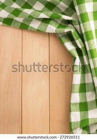 cloth napkin on wooden background - stock photo