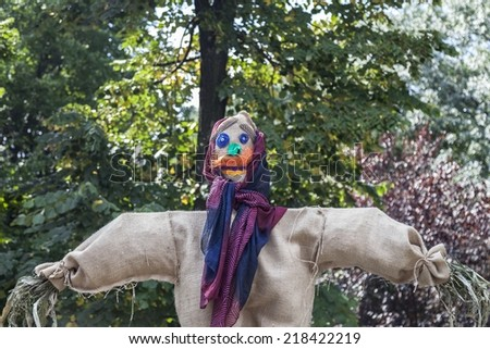 Cloth scarecrow in a rural fair - stock photo