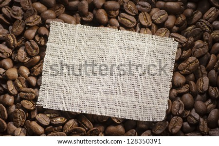 Cloth tag on coffee background - stock photo