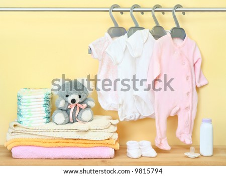 clothes and accessories for newborn - stock photo