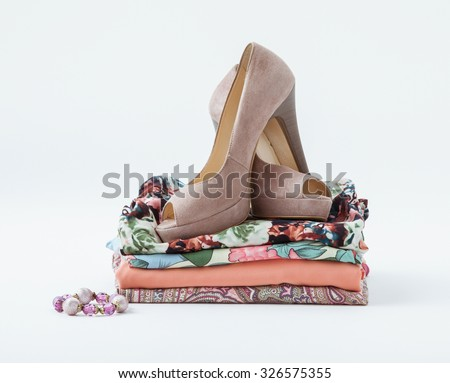 Clothes and shoes on white background - stock photo