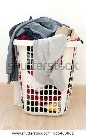 Clothes basket on floor in room. - stock photo