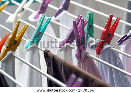 clothes drying on a clothesline with clothespins in different colors