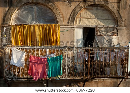 Clothes drying on an apartment balcony