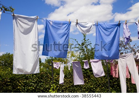 clothes drying on the ropes - stock photo