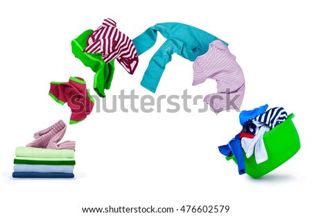 clothes fly out of pile and fall on wash bowl isolated on white background
