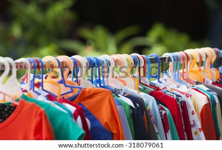 Clothes hang on a shelf