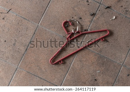 Clothes Hanger on a Messy Floor