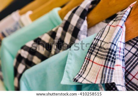 clothes hanger with a lot of dress - stock photo