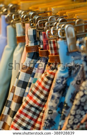 Clothes Hangers,Clothes hang on a shelf in a designer clothes store.-Blurred clothes hangers  - stock photo