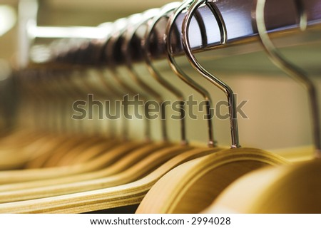 Clothes hangers in the fashion store.  Clothes store concept - stock photo