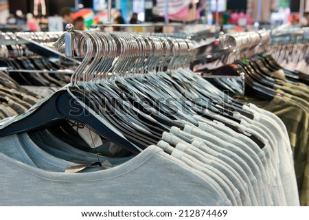 Clothes hangers with clothes in a shop - stock photo