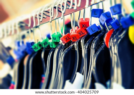Clothes hangers with sizes - stock photo