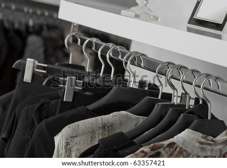Clothes hanging in shop - stock photo