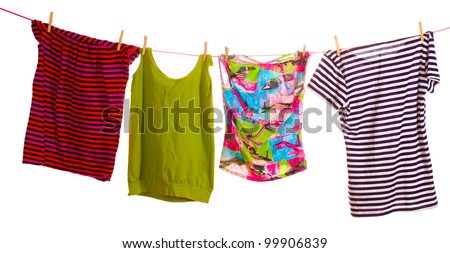 Clothes hanging isolated on white - stock photo