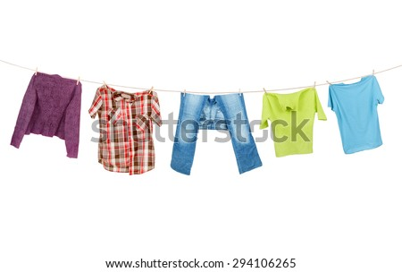Clothes hanging isolated on white background  - stock photo