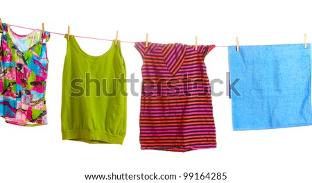 Clothes hanging on a rope isolated on white