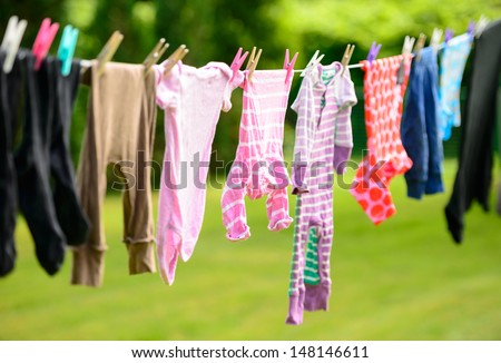 Clothes hanging on line in garden - stock photo