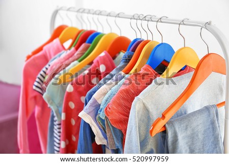 Clothes hanging on rack, closeup
