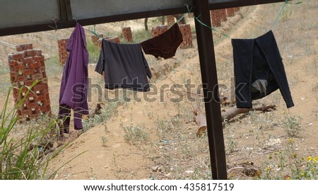 clothes hanging on the clothesline. - stock photo
