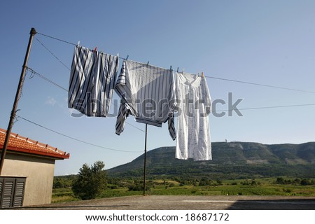 Clothes hanging on the washing line to dry in summer - stock photo