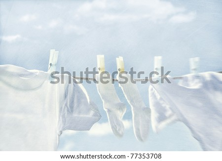 Clothes hanging on wash line - stock photo