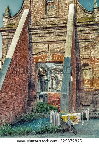 clothes hung out to dry on a drying rack in front of historic ruins in Italy - stock photo
