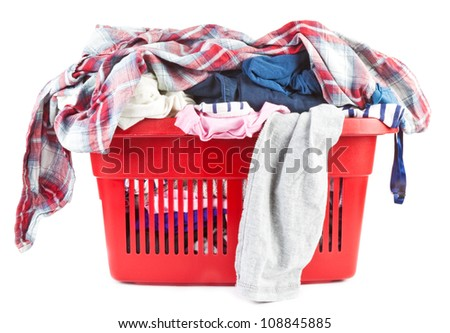 Clothes in a laundry basket - stock photo