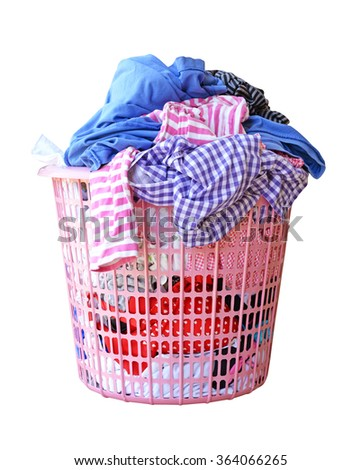 Clothes in a laundry basket isolated on white background (clipping path) - stock photo