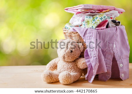 Clothes in a laundry basket on Wood floor,Natural background blur - stock photo
