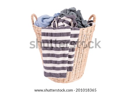 Clothes in a laundry wooden basket isolated on white background - stock photo