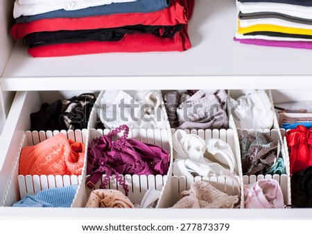 Clothes in a wardrobe - closeup shot - stock photo