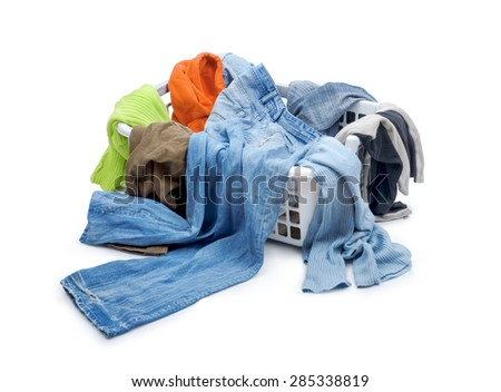 Clothes in plastic basket dropped isolated on white  - stock photo