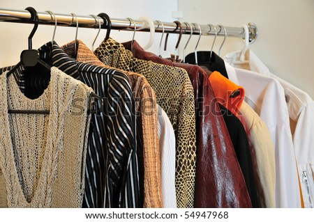 clothes in the wardrobe - stock photo