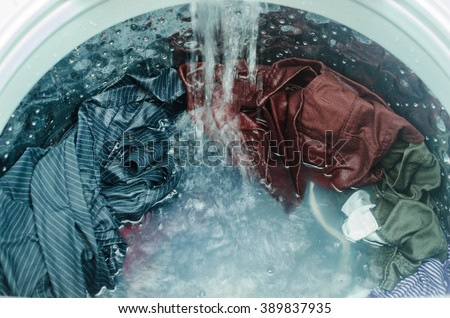 Clothes in washing machine - stock photo